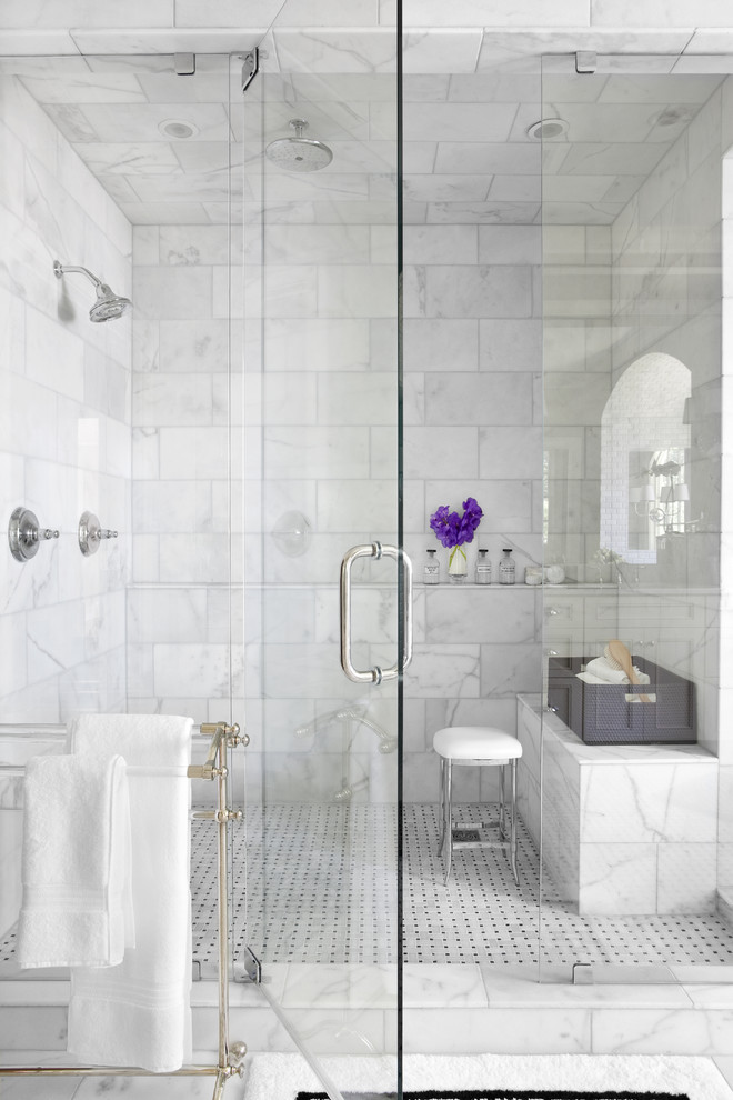modern walk in bathroom with pull out glass door stainless steel fixtures permanent bench made of marble white top stool traditional floors with black dot motifs white marble walls