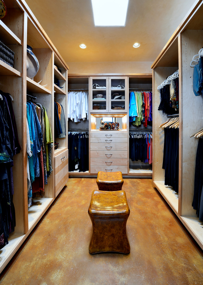 modern walk in closet organizer in white finishing and wood color accent wood floorings and a couple of unique chairs at the center