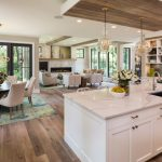 Open Kitchen With Brown Wooden Floor, White Cabinet, White Counter Top, Brown Wooden Dropped Tray Ceiling In The Kitchen