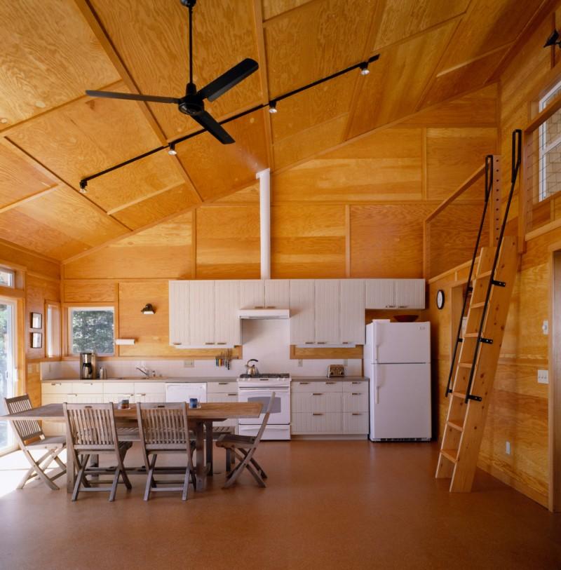 plywood made kitchen idea white flat panel cabinets white finish appliances white backsplash white oak dining furniture black ceiling fan traditional ladder
