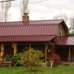 Red Metal Roof Wooden Wall Spacious Porch Wood Beams Stone Chimney