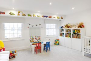 room decor with toy toys wall decor shelves small chairs table windows ceiling lamp kids room dolls books decoration