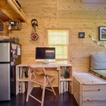 Rustic Bedroom With White Bed With Square Wooden Bedding
