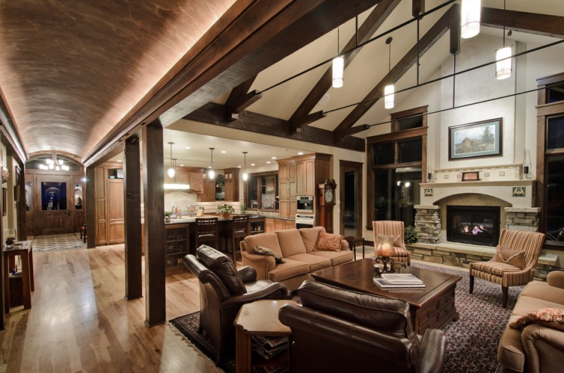 Rustic Living Room Open To Kitchen With White Vaulted Ceiling Wooden Beams Brown Furniture