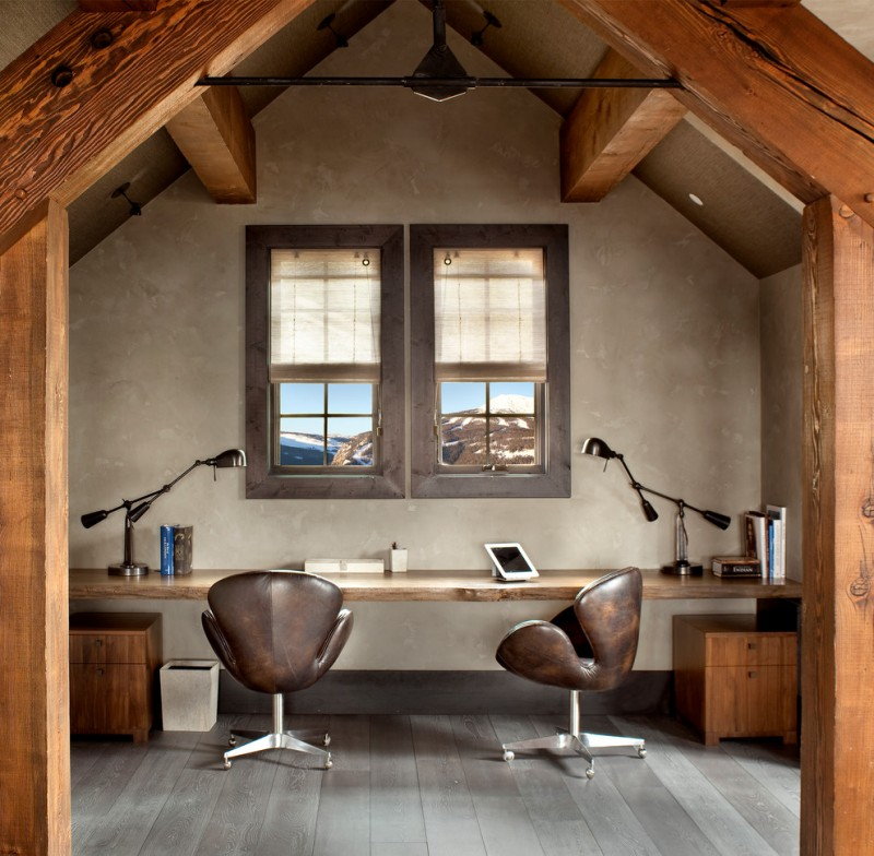 rustic office in the attic with brown leather swivel chair, wooden table