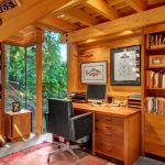 Rustic Office Near The Window With Wooden Wall, Wooden Table, Wooden Shelves, Rug, Wooden Cabinet