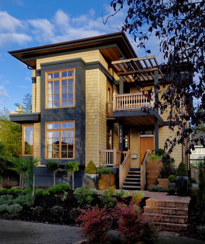 semi traditional modern house exterior idea with light beige wall finishing modern glass windows with black background and wood trims flat roof and wood stairs