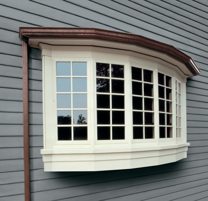 showroom exterior window with white trims and glass panels