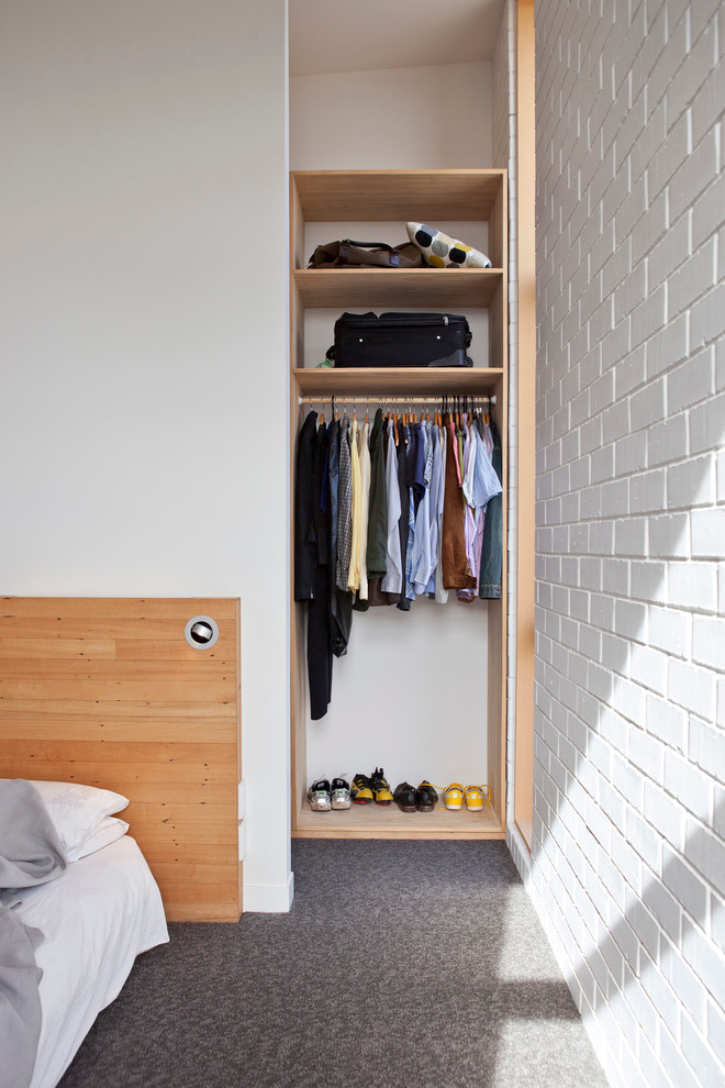 simple and modern reach in closet organizer with wooden storage system