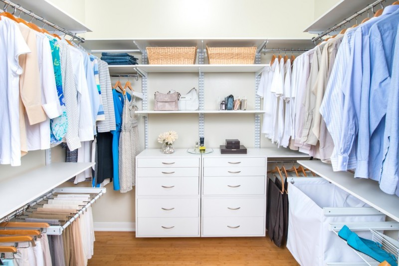 simple & modern white walk in closet organizer consisting of floating cabinetery open shelves and lower & upper hanging sections