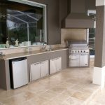 Simple Summer Kitchen With Brown Flooring, Brown Countertop, Grey Counter, Barbeque Grill, Cooker Hood
