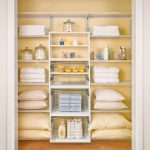 Small Closet Organizer Made Of Light Wire Material In White And Consisting Of All Shelves For Linens And Bathing Supplies