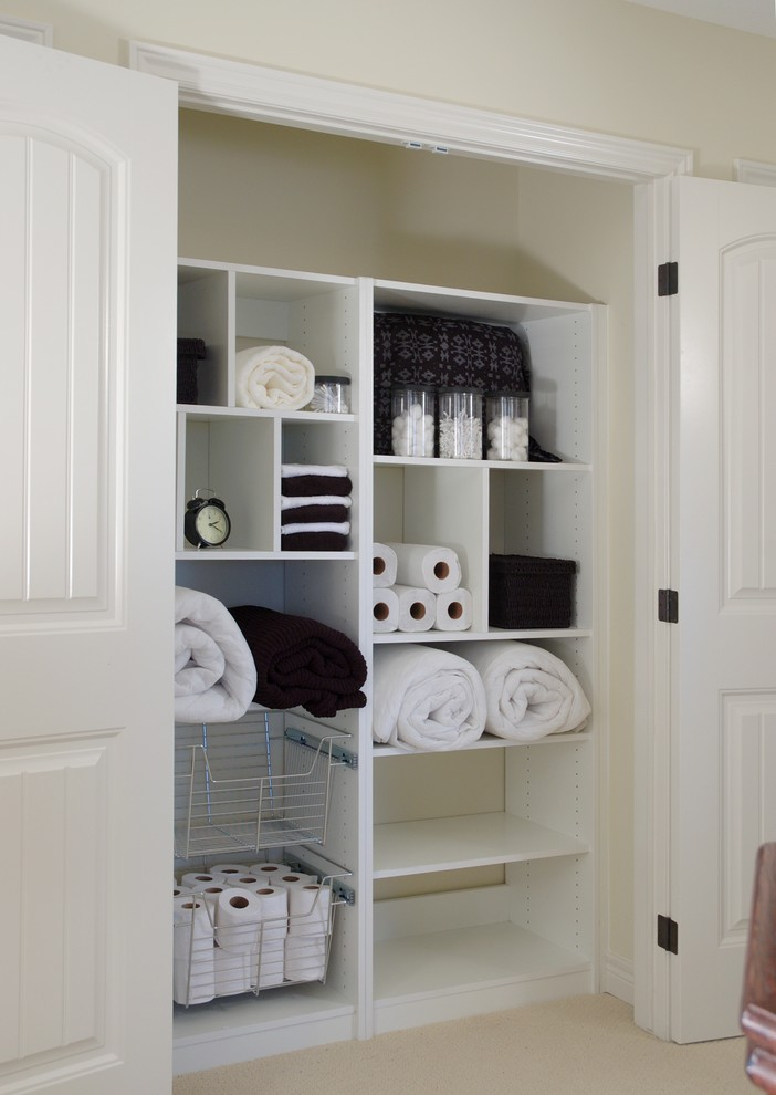 small linen closet system in white
