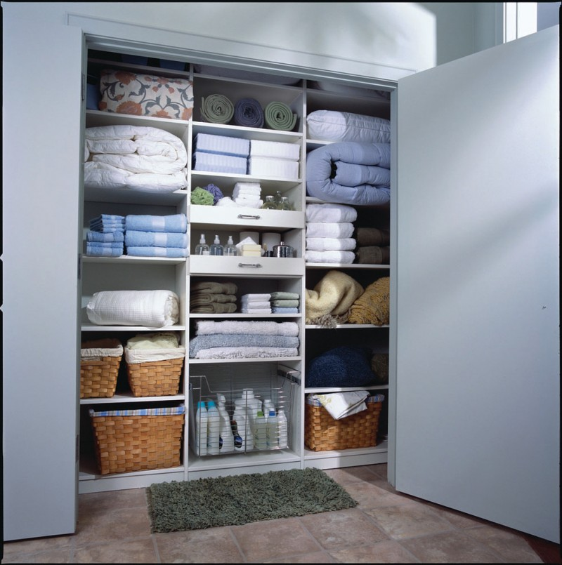 small modern closet organizer for linens and supplies dark green mat