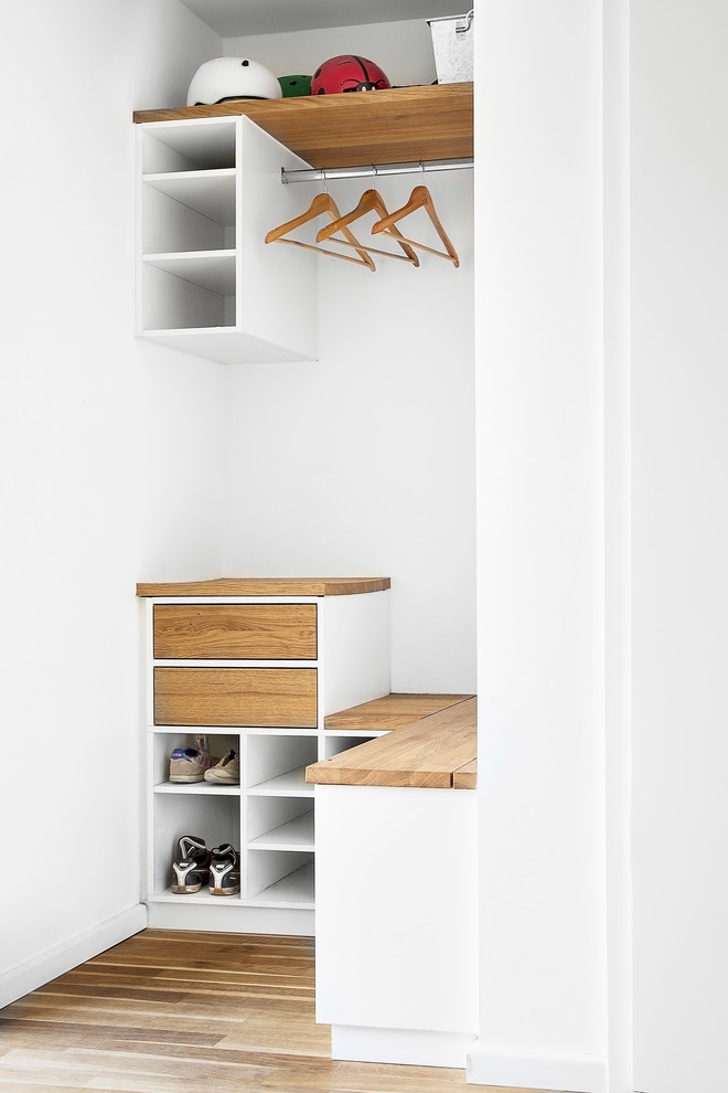 small & modern closet organizer idea in white and wood color finishes