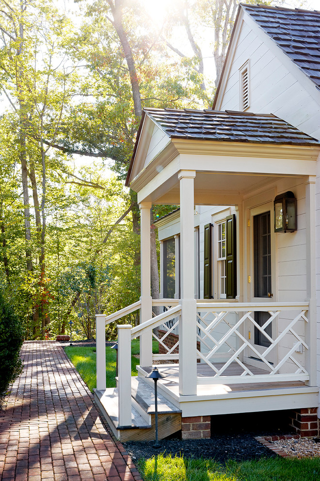 small traditional porch with simple white railings made of wood