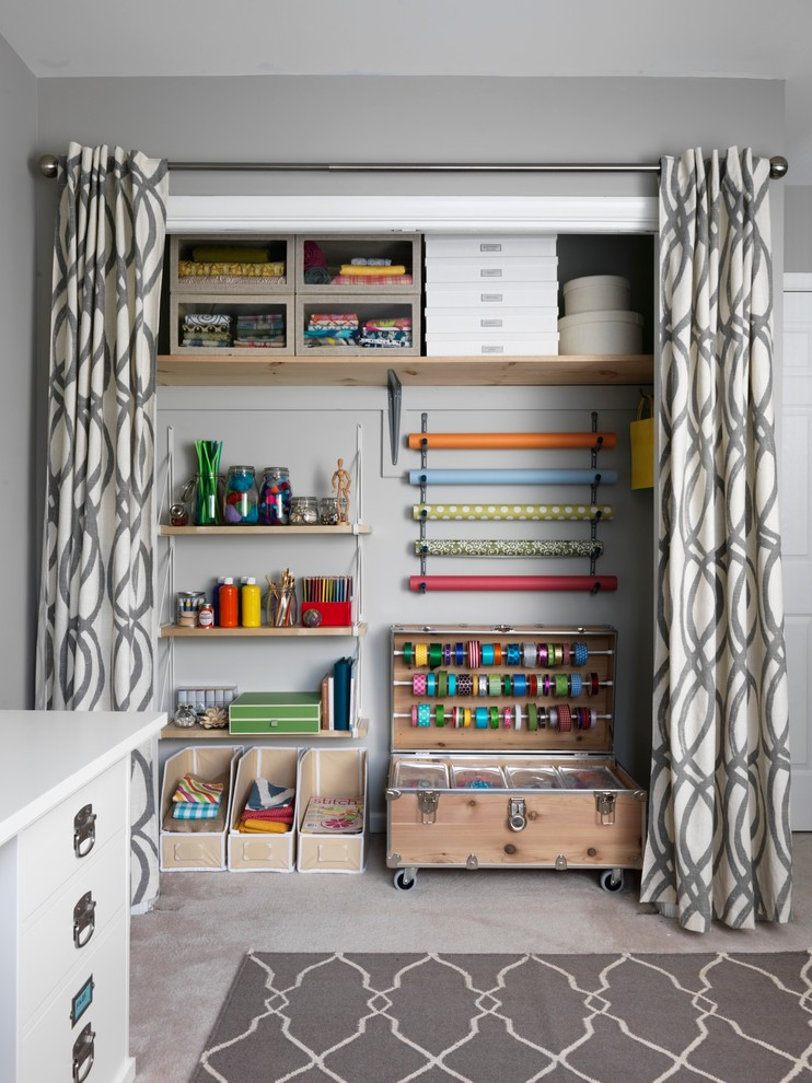 small walk in closet with linen curtain