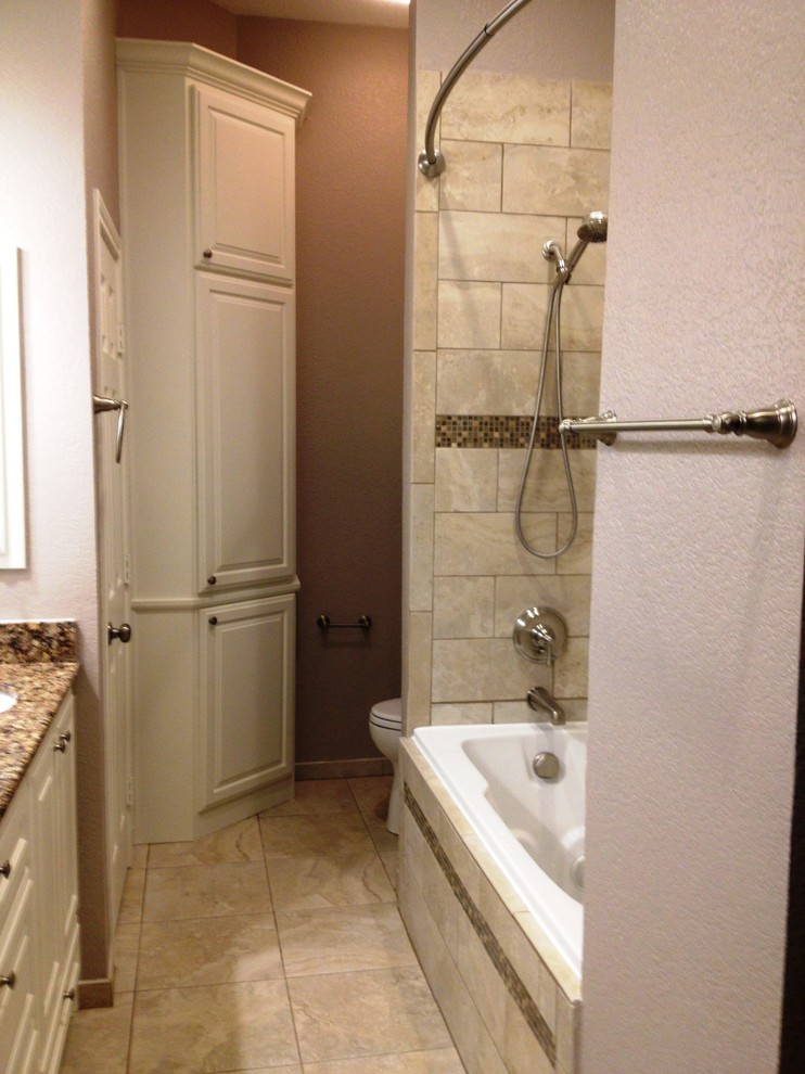 soft brown small master bathroom with toilet in the separated room