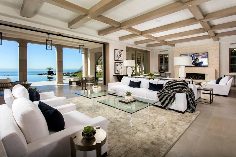 spacious hall wood ceiling glass coffee table white sofa brown fur rug dark pillow square pendant lights