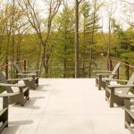 Stainless Steel Cable Railings Idea With Red Aluminum Post Wraps In Lake House's Deck Many Items Of Grey Chairs For Outdoor