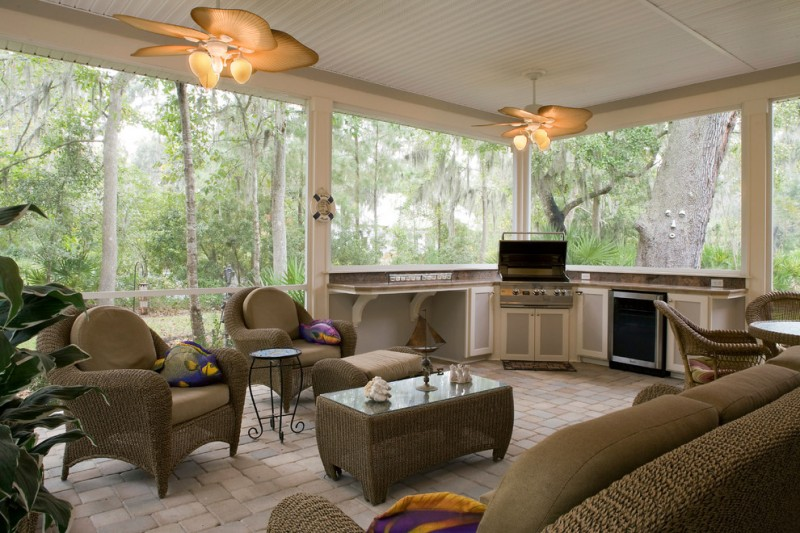summer kitchen in the second floor with ceiling lamp fan, brown rattan sofas set, whote counter, brown top, large windows