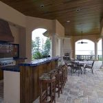 Summer Kitchen With Mexico Tiles, Brown Wooden Bar And Counter, Wooden Chairs In Bar, Wooden Ceiling
