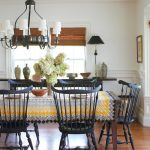 table cloth for wood dining room table carpet wood floor lamp chairs windows blinds chandelier flowers wall decor