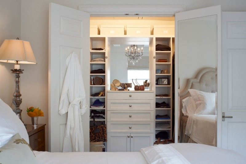 traditional closet organizer idea with door and mirror at the back door