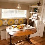 Traditional Corner Kitchen Set With White Wooden Bench, Brown Seating Cushion, Yellow Flower Back Cushion, Roudn Wooden Table, White Wooden Shelves, Pendant