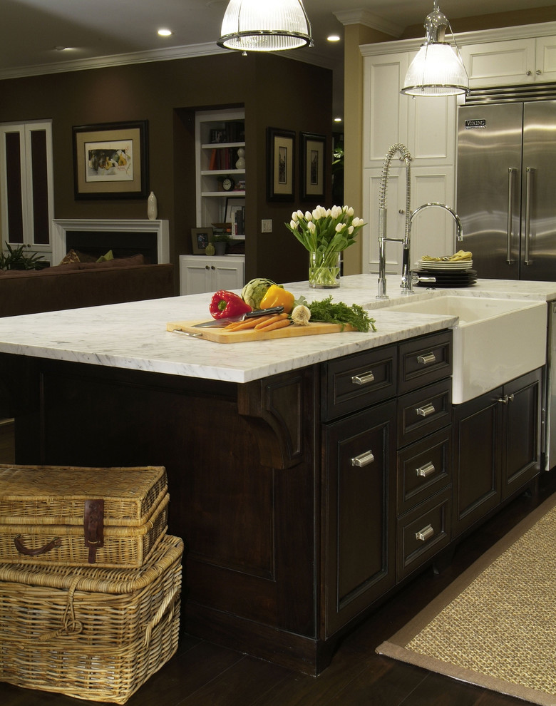 traditional kitchen with dark wood flooring, dark wood cabinet, white counter top, white pendant