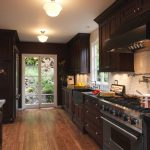 Traditional Kitchen With Wood Floor, Dark Wood Cabinet, Soft Light Brown Backsplash
