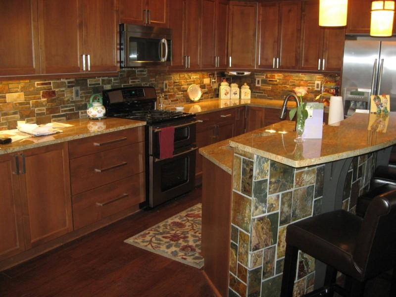 traditional kitchen with wood flooring, dark wood cabinet, dark wood island, tiles in island, tiles in backsplash