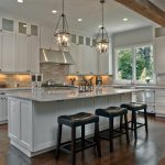 Traditional Open Kitchen With Wooden Flooring, White Cabinet, White Counter Top, LED Lights, Pendant Lights, White Ceiling, Wooden Beam Partition In The Ceiling