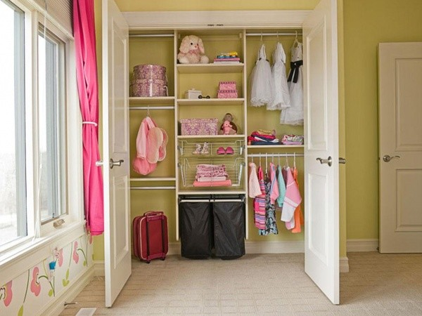 traditional walk in closet for kid which consists of upper and lower hanging sections wire made shelving system open shelves and black bags storage