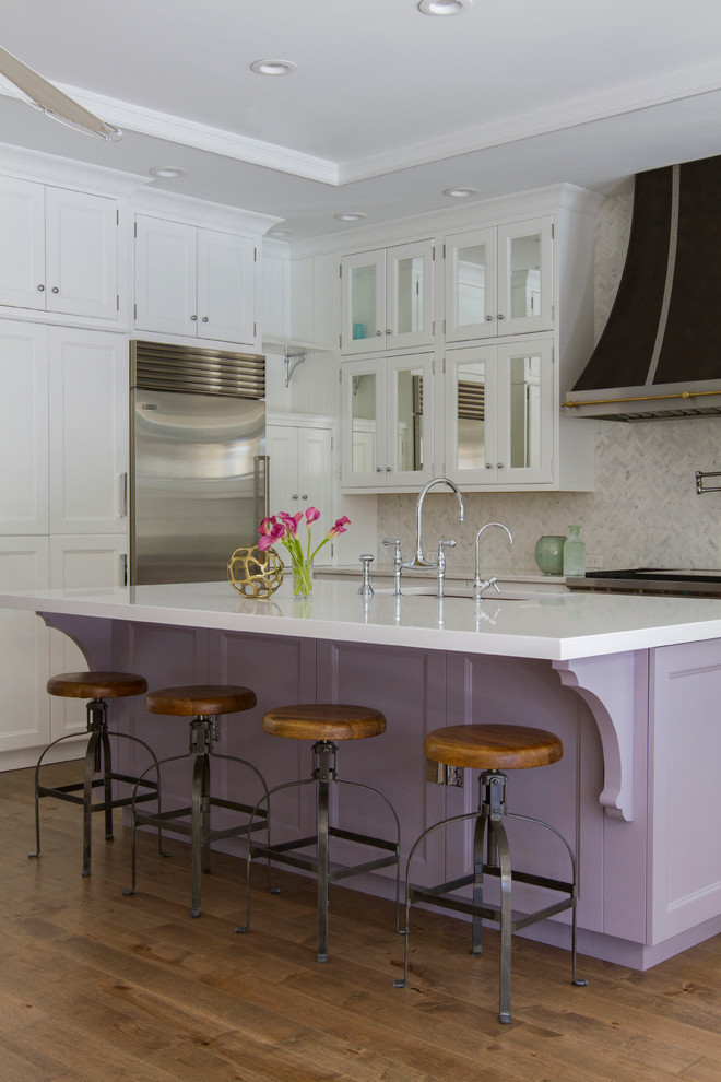 transitional kitchen idea with lavender base and white top kitchen island white wallpaper walls white cabinetry round stools
