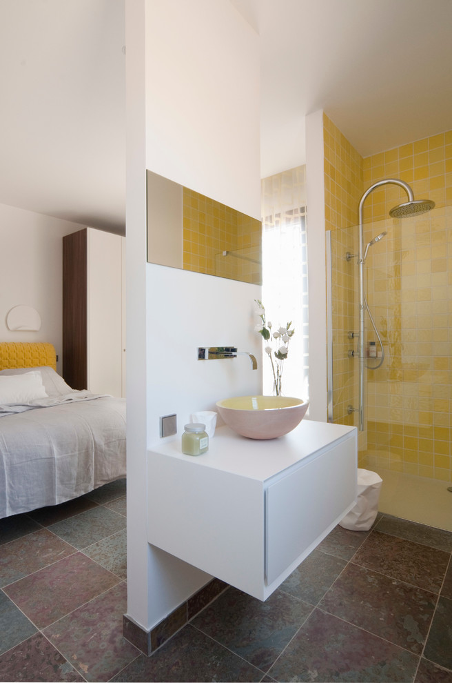 trendy and minimalist bathroom with yellow tiles for shower walls white floating vanity with free standing vessel sink walk in shower with glass panel stainless steel appliances