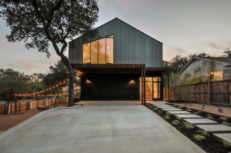 trendy exterior house with asymmetric glass windows