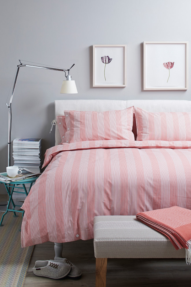 trendy pink bed sheet with stripes motifs pink stripes pillow shams bed set with white headboard small turquoise bedside table modern standing lamp