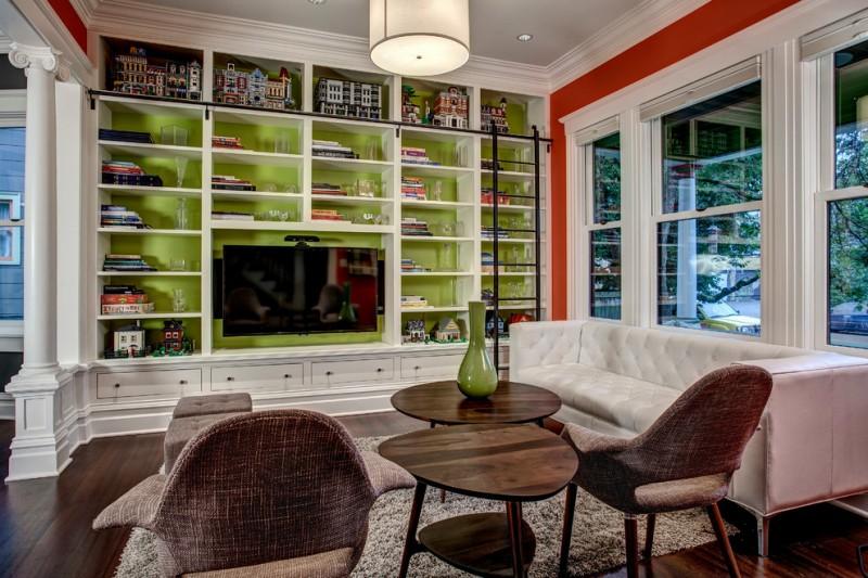 tv display decoration arts crafts table chairs sofa windows glass wood floor carpet family room interior