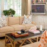 tv display decoration carpet sofa pillows table books cabinets bookshelf window glass curtain lighting