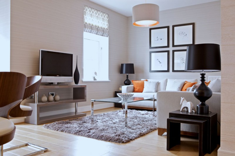 tv display decoration carpet table light hardwood floor modern chairs window wall decor sofa pillows lamps