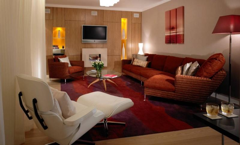 tv display decoration carpet wood floor sofa pillows light warm lighting wall storage glass top table