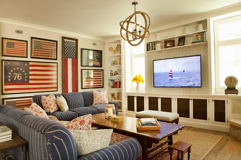 tv display decoration medium tone hardwood floor coastal room sofa pillows table small backless chair shelves wall decor