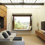 tv display decoration modern family room sofa pillows wall storage wood big window glass lamp