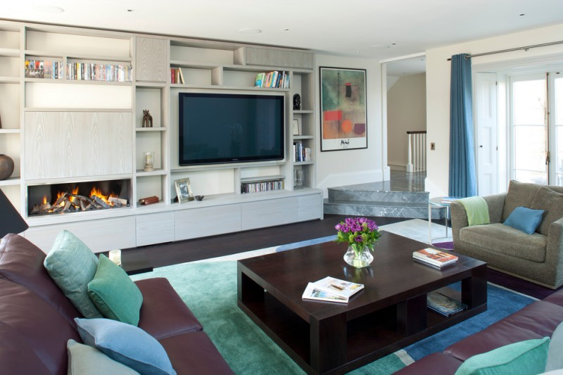 tv display decoration ribbon fireplace carpet sofa pillows curtain painting book table flowers bookshelf