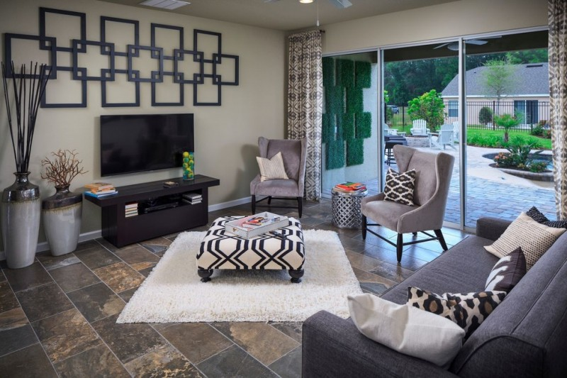 tv display decoration slate floors family room sofa pillows glass curtains table carpet wall decor books