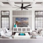 tv display decoration sofa pillows cabinets table windows ceiling fan lamp curtains white blue grey