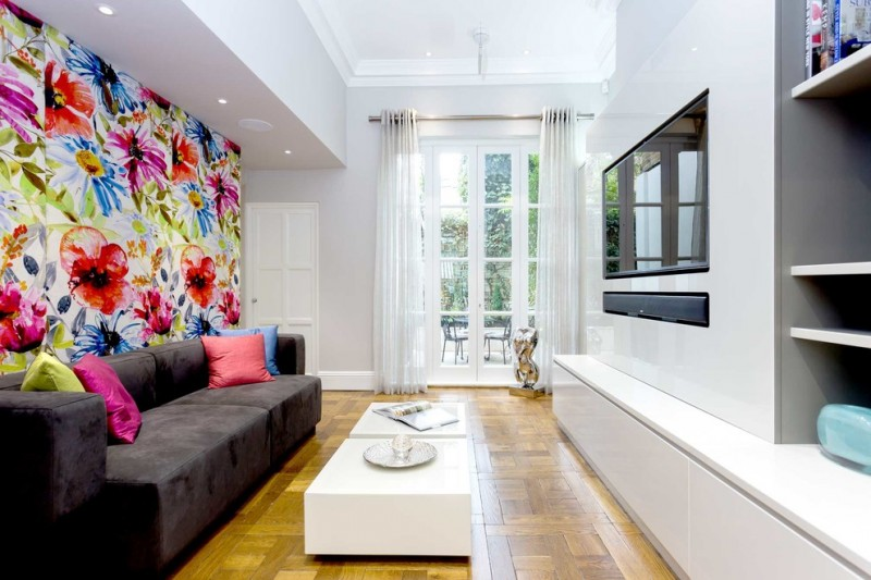 tv display decoration sofa pillows door glass curtains shelves books table big painting wall decor lighting