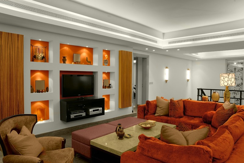 tv display decoration sofa pillows wall lamps lighting lights table orange color loft style family room