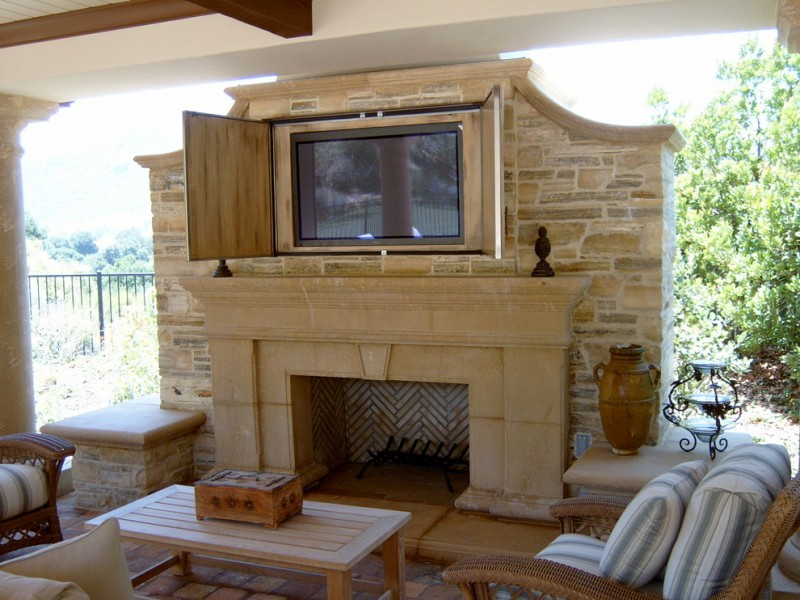 tv display decoration table chairs pillows fireplace stone traditional design patio floor tile gathering area